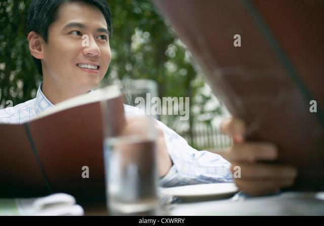 Businessmen having lunch together - Stock Image