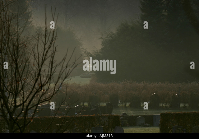 Foggy graveyard - Stock Image