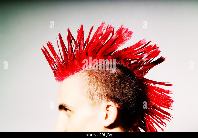 Side view of Punk rocker with red mohican - Stock Image