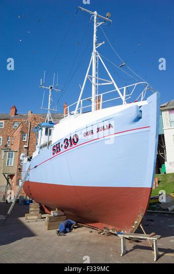 wooden-fishing-boat-being-repainted-brid