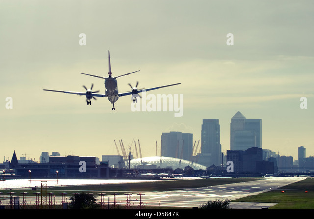 Commercial airplane landing at London City Airport, England, UK. - Stock Image