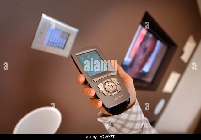 A CONTROL PANEL IN A SMART HOUSE WITH INTEGRATED SYSTEMS OF SECURITY AUDIO VISUAL HEATING AND LIGHTING UK - Stock Image
