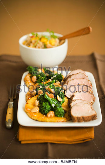 Platter of Pork Tenderloin with Cashew Broccoli - Stock Image