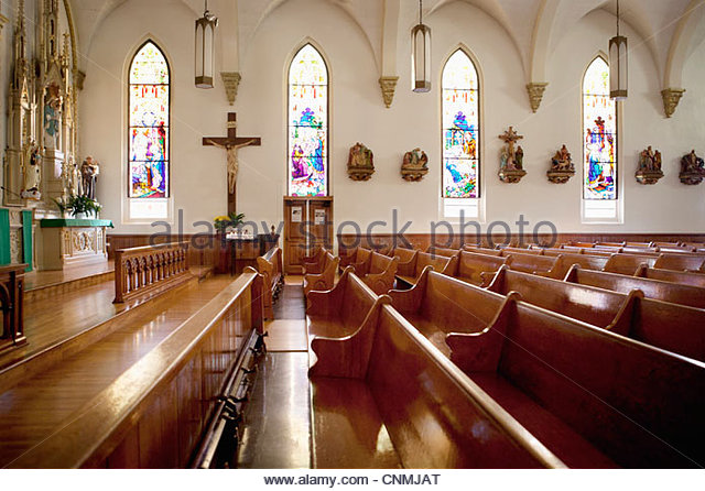 pews-and-stained-glass-windows-in-church