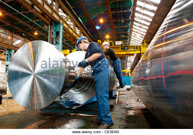 Engineer working on metal machinery - Stock Image