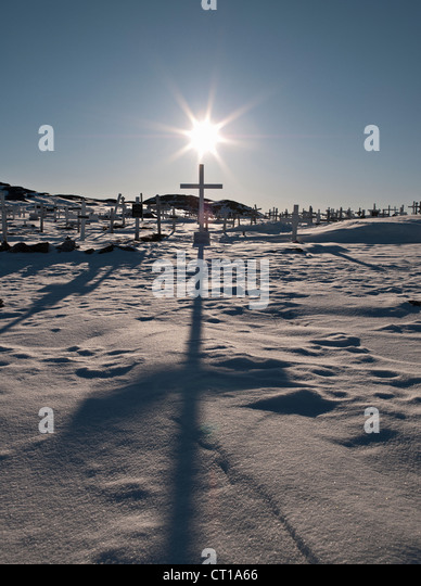 Crosses in graveyard casting shadows - Stock Image