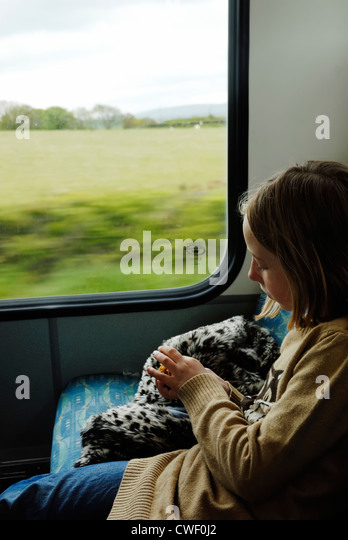 young-girl-eating-while-traveling-on-a-b