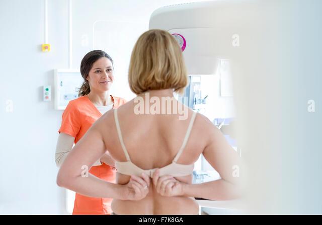 nurse-helping-patient-prepare-for-mammog