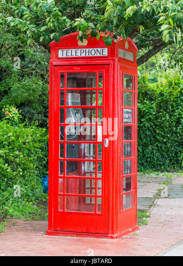 Freshly painted old British Telecom red K6 model telephone box in the UK. - Stock Image