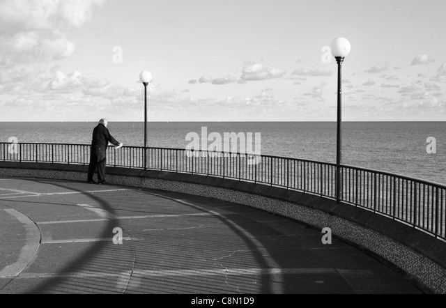 man-looking-out-to-sea-eastbourne-east-s