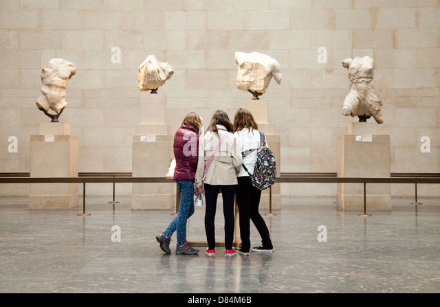 three-teenage-girls-teenagers-looking-at