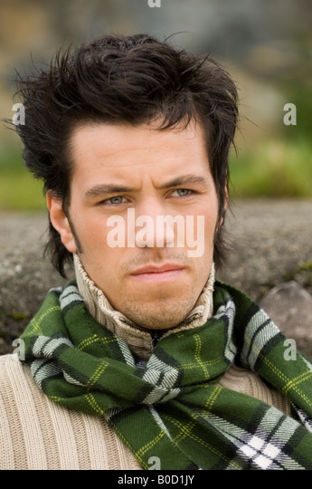 Male portrait looking thoughtful - Stock Image