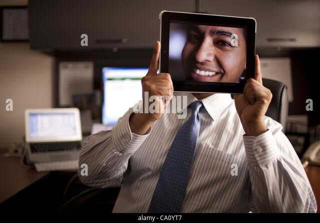 March 5, 2012 - Plymouth, MN, U.S. - Rob Mehta, sales manager at Coldwell Banker Burnet and past president of the - Stock Image