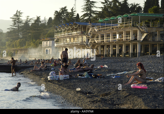 People on the beach of Sukhumi, capital of Abkhazia. - Stock Image