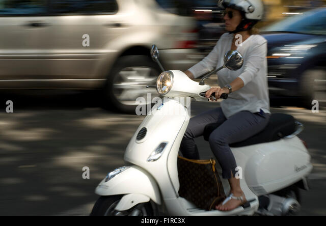 women-on-a-white-moped-in-france-motion-