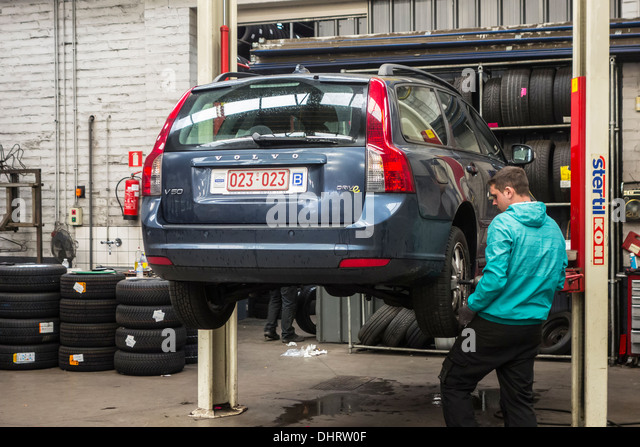 car-mechanic-changing-summer-tyres-and-m
