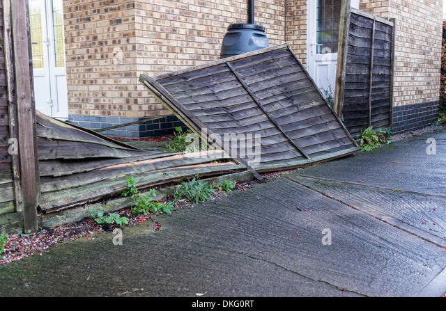 a-wooden-garden-fence-blown-over-in-stor