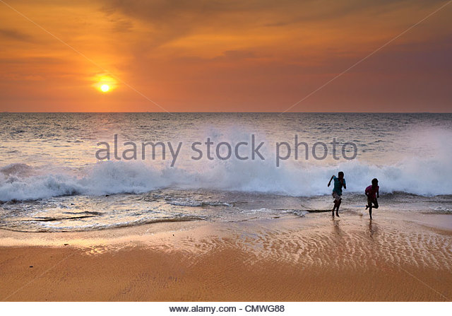 Sri Lanka - children playing on the beach, Koggala Beach - Stock Image