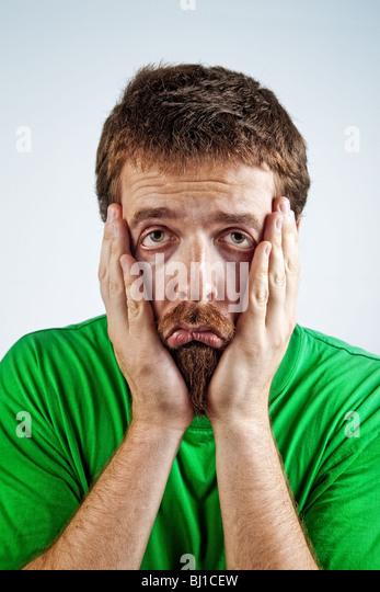 Portrait of sad unhappy bored depressed man - Stock Image