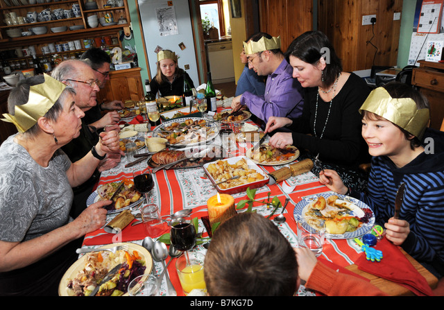 Family Christmas Dinner in a large family kitchen Cumbria UK Model Released - Stock Image