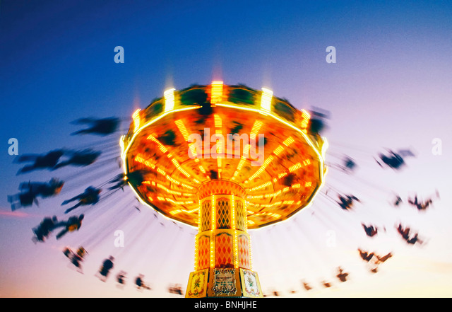 Sweden Stockholm Merry go round Action Activity Amusement Amusement park Amusement parks Carousel Chair Emotion - Stock Image