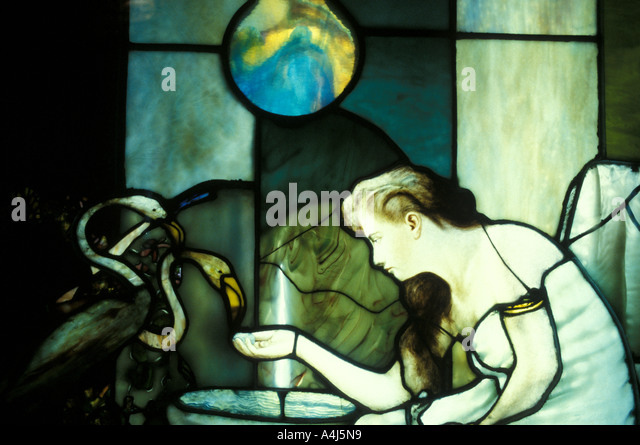 Louis Comfort Tiffany stained glass window art work 'woman with flamingos' - Stock Image