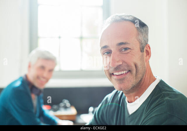 Gay couple relaxing together - Stock Image