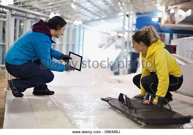 Female  athlete with coach practicing on track - Stock Image