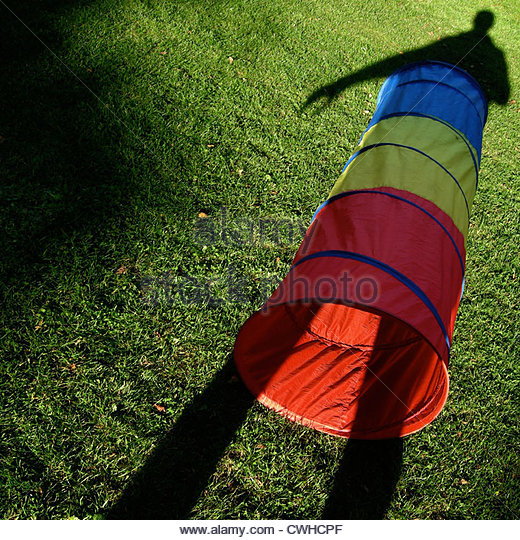 meadow,shadow,toy,tube - Stock Image