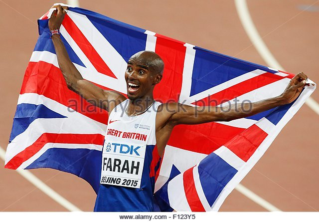 epa04892938 Mohamed Farah of Great Britain celebrates after winning the men's 10000m final during the Beijing - Stock Image