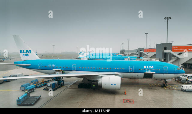 KLM airplanes on tarmac at Schiphol Airport in Amsterdam, Netherlands. KLM is the flag-carrier airliner of the Netherlands - Stock Image