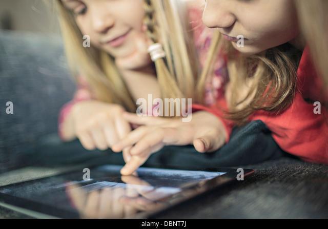 Two girls using digital tablet, Osijek, Croatia, Europe - Stock Image