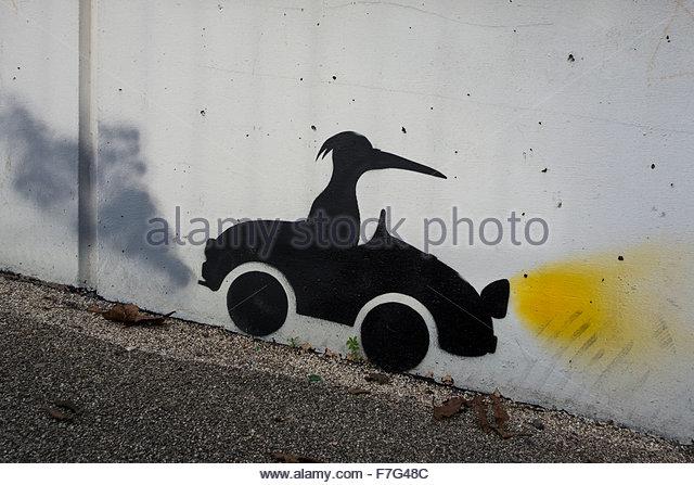 stencil-graffitti-car-going-downhill-rid