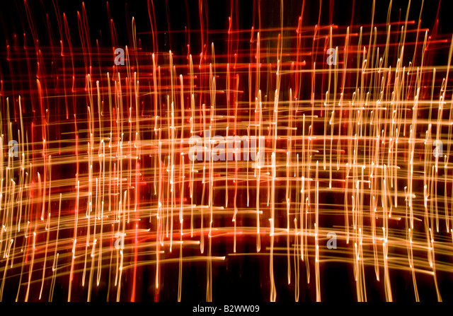Candle Flames Abstract taken with slow shutter speed in a cathedral - Stock Image