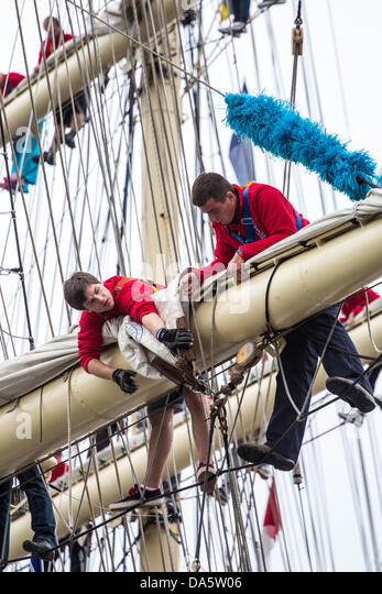 Aarhus, Denmark. 4th July, 2013. Young crew members working the sails during The Tall Ships Races 2013 in Aarhus, - Stock Image