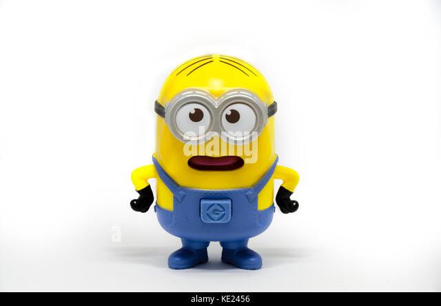 A minion toy photographed against a white background. - Stock Image