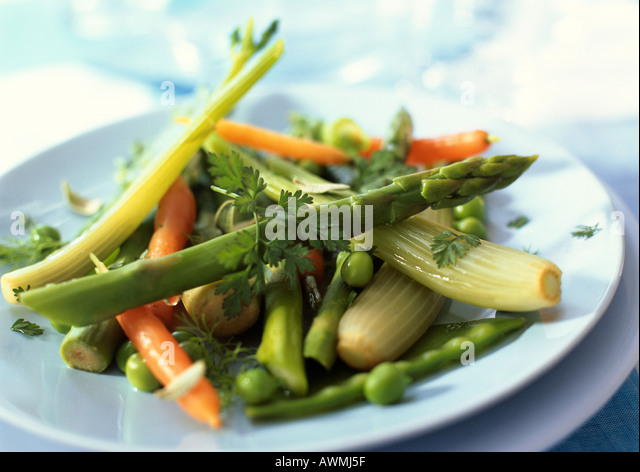 Plate of spring vegetables, close-up - Stock Image