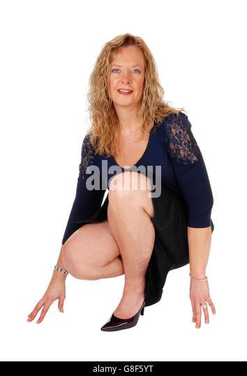 фото женщины сидя на корточках-эф1
