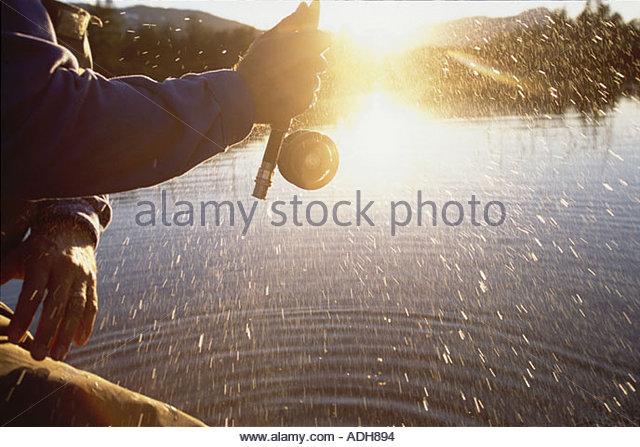 Man Flyfishing in Portage w Closeup of Reel Spinning AK Summer - Stock Image