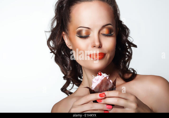 Gourmet. Woman Holding Unhealthy Food - Appetizing Chocolate Muffin - Stock Image