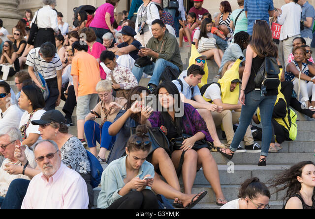 crowd-of-people-sitting-on-steps-with-fo